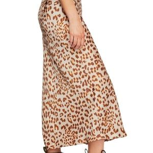 Free People Skirts - Normani Leopard Print Midi Skirt